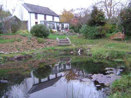 The original farmhouse with pond